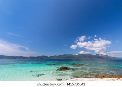 white beach with coral reef tropical sea in lipe island thailand