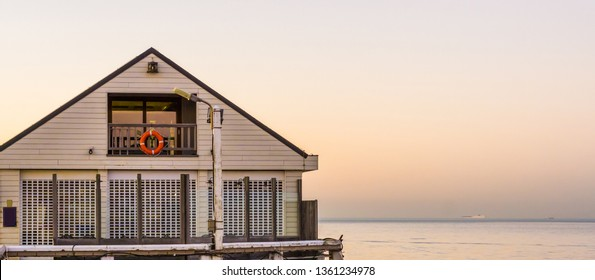 white beach house on the pier of Blankenberge, Belgium, Architecture of the Belgian coast at sunset