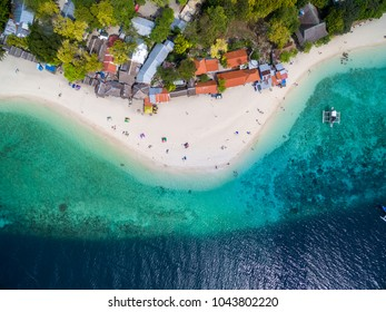 White Beach Moalboal in Cebu, Palawan, Philippines. Boat and Ocean Water and Beach.
