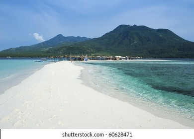 white beach overlooked by volcanos on camiguin island near mindanao in the philippines