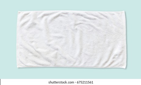 White beach towel mock up isolated with clipping path on blue background, flat lay top view