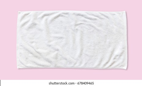 White beach towel mock up isolated with clipping path on pink background, flat lay top view