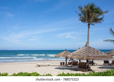 White beach in Vietnam vacation resort with palms on ocean backgrounds
