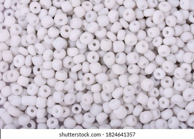 White Beads on the white background. Background or texture of beads. Close up, macro,It is used in finishing fashion clothes. make bead necklace or string of beads for woman of fashion.