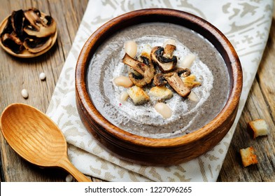 White bean mushrooms soup with croutons. toning. selective focus