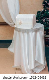 White beautiful casket on a round table. Casket at a wedding event.