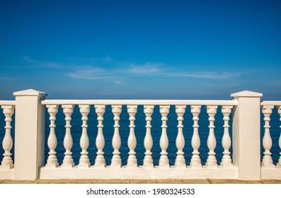 White beautiful fense and sea