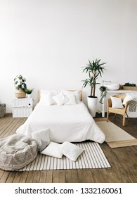 white bed in boho style