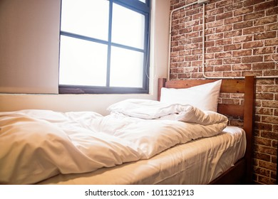 white bed in front of a window