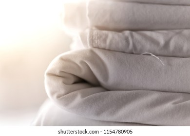 White bed sheet fold on table