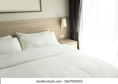 white bedding and pillow in hotel room, pillows on the bed