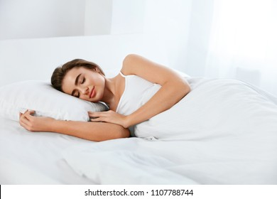 White Bedding. Woman Sleeping On Mattress With Pillow.