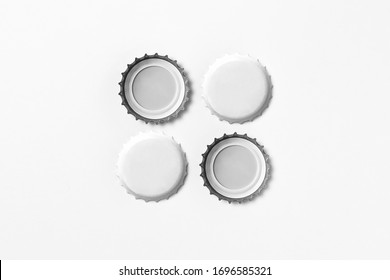 White Beer Caps Mock up isolated on soft gray background, front and back side, top view. Empty metal soda caps mock up design template.High resolution photo.