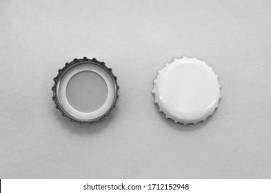 White Beer Caps Mock up isolated on soft gray background, front and back side, top view. Empty metal soda caps mock up design template.