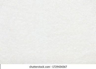 White beige delicate soft background of plush fabric.
