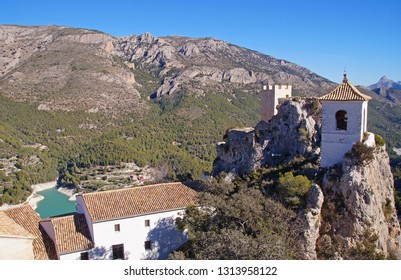 The white bell tower seen from Guadalest Castle in the province of Alicante, Spain