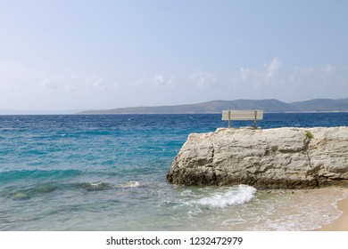 White bench on rock with beautiful wiev , Croatia