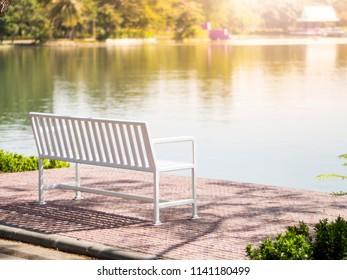 White bench on summer park garden