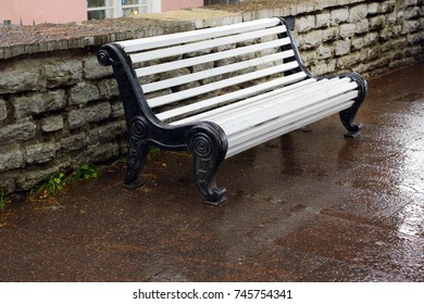 White bench to relax on sidewalk