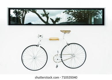 White Bicycle hanger on a white wall background. Bicycle storage.