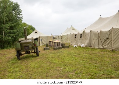 white big army tent and field kitchen