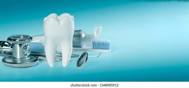 White big healthy tooth and different tools for dental care and stethoscope. On gradient dental background banner size.