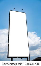 white billboard blank canvas mockup for outdoor advertising poster or blank billboard at day time and cloud and blue sky background .