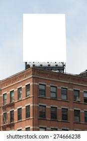 White billboard in the city on the top of the building.