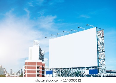 White billboard for mockup and design in the city area.For customer information services and advertising,Business Marketing.Frame.label.