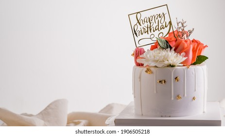 White Birthday cake with pink rose and fresh strawberry over light grey.food concept anniversary and wedding background.
