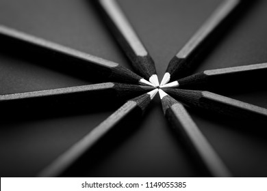 White and black colored pencils. stylish business concept, on black background