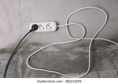 white and black electric extension cables