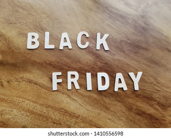 White Black Friday Texts on Wooden Table Background