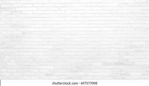 White black and gray horizontal brick wall. Old uneven textured surface on a building in the city. Urban background in grayscale. White painted bricks.