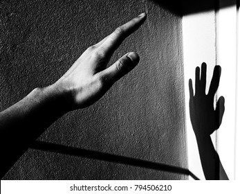 White and black of a hand with shadow on the wall, Requests, Assistance, and Claims concept.