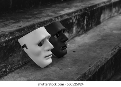 White and black mask on the stairs as the good and bad of mind to choose those things.