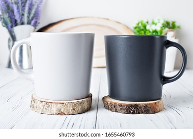 White and black mugs on a background of flowers . Mock up. Template Space for Creative Artwork Lettering Text Product Promotion Branding. Elegant style.
