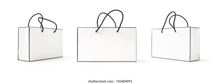 White and black paper shopping bag collection isolated on white background. Mockup for advertising and branding