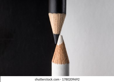 White and black pencils. Contrast and opposite concept