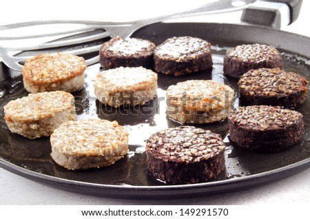 white and black pudding on a pan