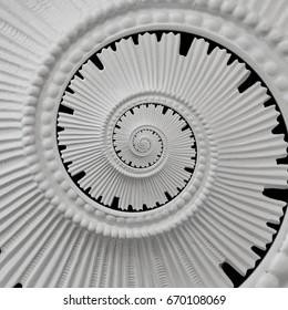White black stucco moulding plasterwork spiral abstract fractal pattern background. Plaster abstract spiral effect background. Spiral abstract background. Decorative stucco element concept fractal