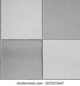 White and black tiles floor. Closed up of glossy ceramic brick tiles floor texture, seamless tile pattern in a bathroom.