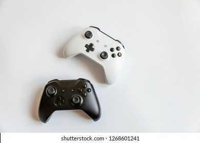 White and black two joystick gamepad, game console isolated on white background. Computer gaming technology play competition videogame control confrontation concept. Cyberspace symbol