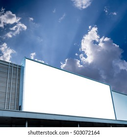 White blank billboard on facade of modern building with white cloud and blue sky for outdoor advertising with clipping path