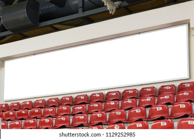 White Blank Billboard  with Red Plastic Seats in Basketball Arena or Volleyball Stadium. Empty advertising screen at indoor hall.