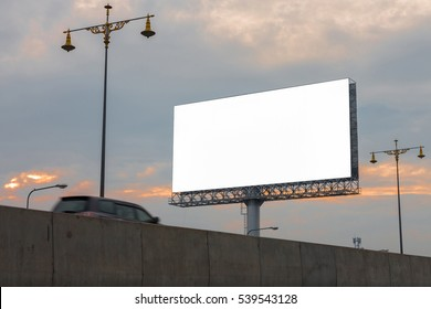White blank billboard and sunlight of sunrise in the morning - can advertisement for display or montage product and business