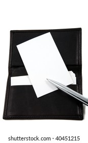 White, blank business card in leather card holder, with writing pen