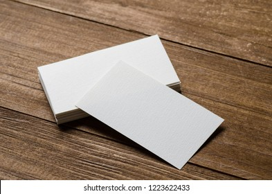 white blank business card on a wooden background
