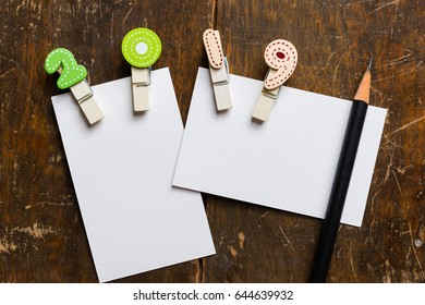 White blank card with colorful clip 2019 wood background