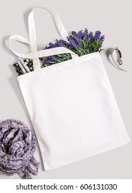 White blank cotton eco tote bag with lavender flowers, magazine, watches and scarf. Design mockup.